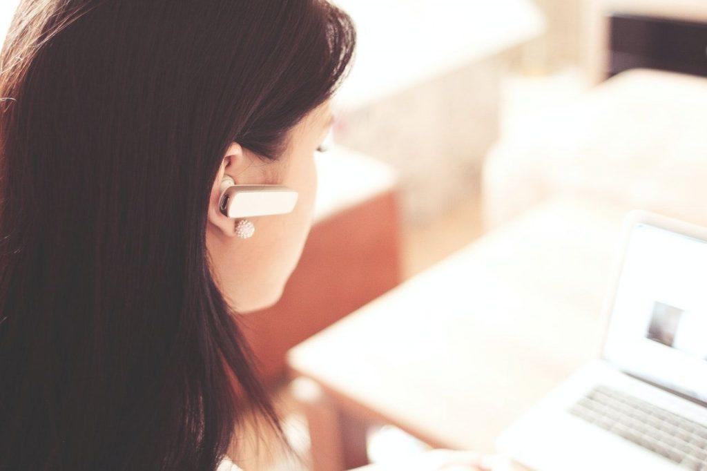 Women wearing Bluetooth Headset